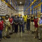 La delegada del Gobierno, Gloria Calero, visita el almacén provincial de alimentos de Cruz Roja en Valencia